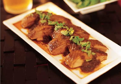 Duck braised in dark soy and tamarind