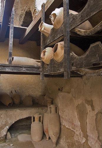 wine amphorae in original wooden racks
