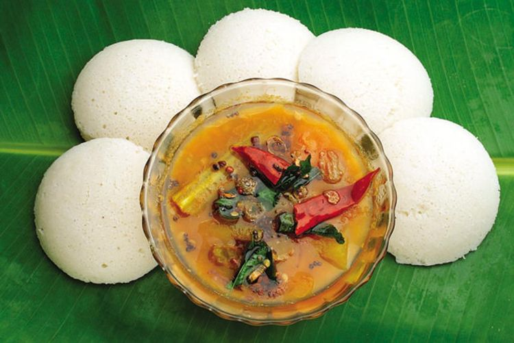 Idli Sambar on a banana leaf